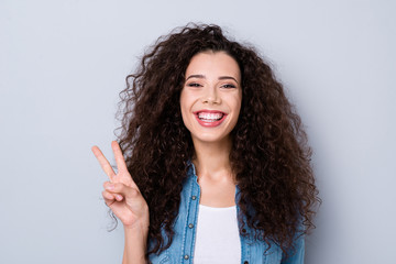 Close-up portrait of her she nice cute charming attractive lovely cheerful cheery positive optimistic wavy-haired girl showing v-sign isolated over gray pastel background