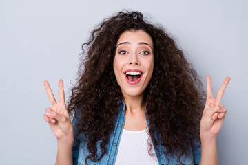 Close-up portrait of her she nice cute charming winsome sweet attractive lovely cheerful positive optimistic funny wavy-haired girl showing double v-sign isolated over gray pastel background