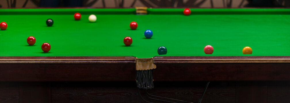 snooker ball on the green snooker table at snooker club