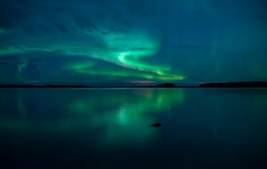 Wall Mural - Northern lights background in Farnebofjarden national park in Sweden.