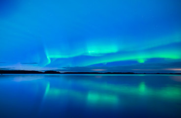 Northern lights background in Farnebofjarden national park in Sweden.