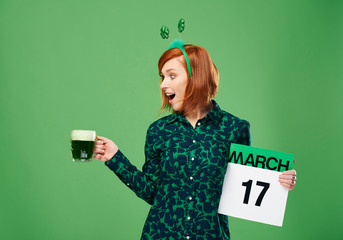Screaming woman with a full mug of beer and calendar