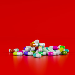 Different pharmaceutical medicine pills, tablets and capsules in different colors on red background. Health care concept. 3D render illustration.
