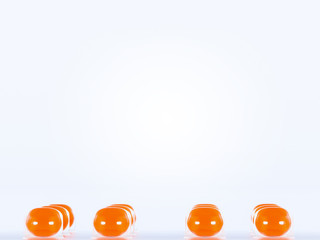 Pills blister with orange round tablets on white background. Health care concept. Space for text. 3D render illustration.