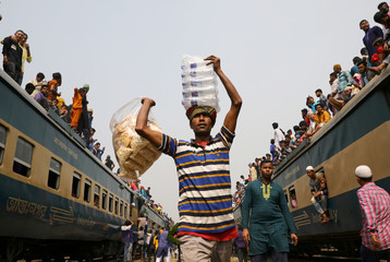 "Man sells water and dry food at a rail station during the final prayer meeting of ""Bishwa Ijtema"", the world congregation of Muslims in Tongi"
