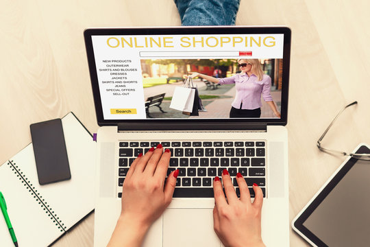 Girl shopping on-line on laptop, using online store, shopping through electronic application, signing in on website, close up, rear view