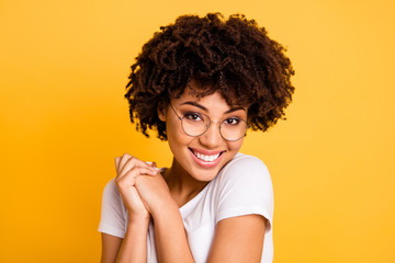 Close-up portrait of her she nice cute charming attractive beautiful cheerful pleased wavy-haired lady eyeglasses eyewear holding hands isolated over bright vivid shine background