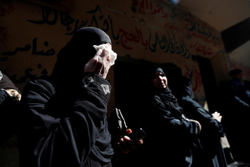 Woman reacts during the funeral of Egyptian police officer Mahmoud Abou El Yazied who was killed in a blast, in Cairo
