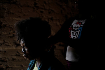 Dalina Paul has her hair combed by another girl in Boucan Ferdinand