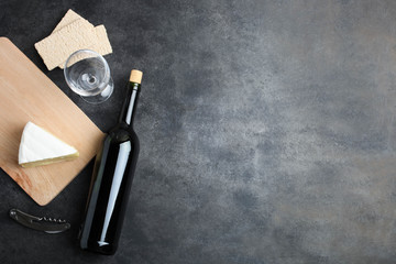 white Camembert cheese, crispbread and bottle of wine