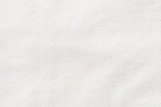 White canvas burlap texture background of cotton natural fabric cloth for wallpaper and design backdrop