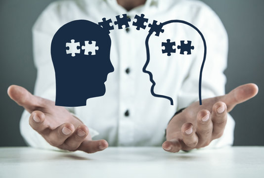Man holding heads with puzzle pieces. Problem solving concept
