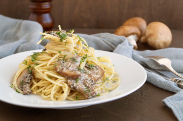 Spaghetti with mushrooms in cream sauce. on dark background