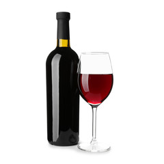 Bottle and glass of tasty wine on white background
