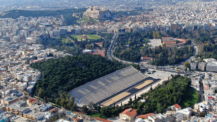 Aerial drone photo of iconic ancient Panathenaic stadium or Kalimarmaro as seen from distance and Acropolis hill, Zappeion at the background, Athens historic centre, Attica, Greece