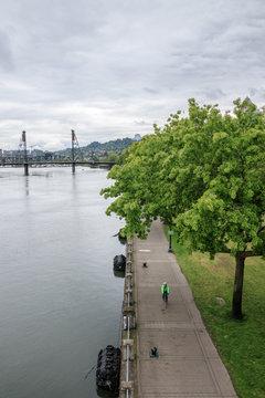 View of .Hawthorne Bridge and Park along willamette river in Portland, Oregon