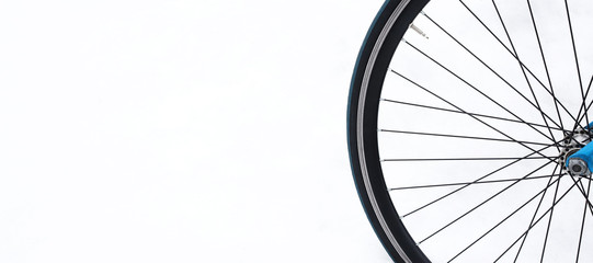 Bicycle wheel in the snow