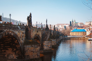 Beautiful view of Charles bridge in Prague on sunny day. Popular tourist attraction. Czech Republic