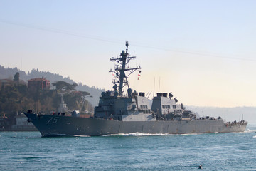 The U.S. Navy Arleigh Burke-class guided-missile destroyer USS Donald Cook (DDG 75) sets sail in the Bosphorus, on its way to the Black Sea, in Istanbul