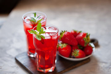 Fresh strawberry lemonade garnished with mint, copy space