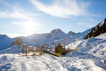 Happy people, children and adults, skiing on a sunny day in Tyrol mountains