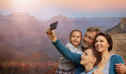 Portrait of happy family taking selfie with smartphone