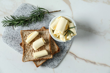 Fotobehang - Tasty toasts with butter curls on table