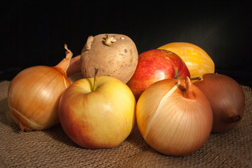 set of vegetables and fruits on a dark background