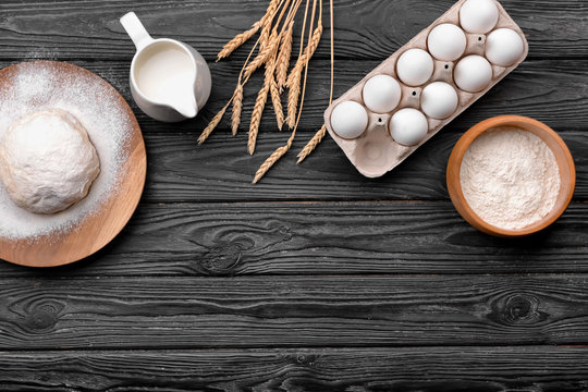 Ingredients for making bread on wooden table
