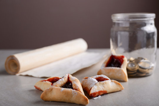Tasty hamantaschen for Purim holiday on table