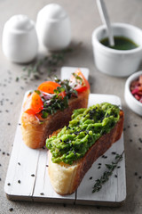 Board with fresh tasty bruschettas on table