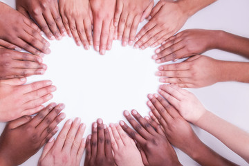 hands in a heart shape multi colour mixed race