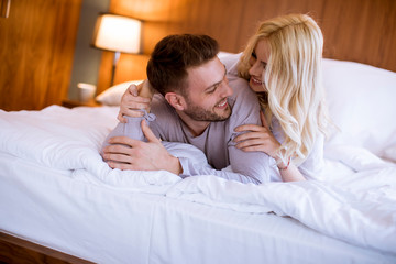 Romantic couple in love lying in bed together