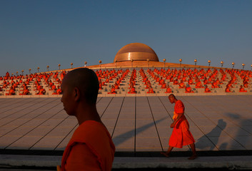 Buddhist monks pray at the Wat Phra Dhammakaya temple during a ceremony to commemorate Makha Bucha Day outside Bangkok