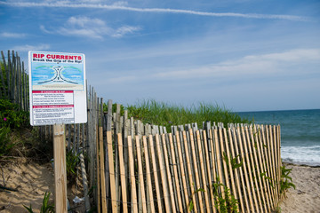 Ditch Plains beach  Montauk Long Island New York in the Hamptons with rip current warning sig