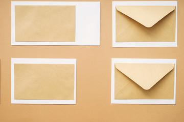 Many blank envelopes on color background