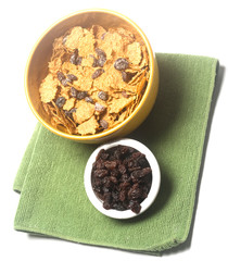 breakfast cereal bowl of raisin bran with bowl of raisins   on white