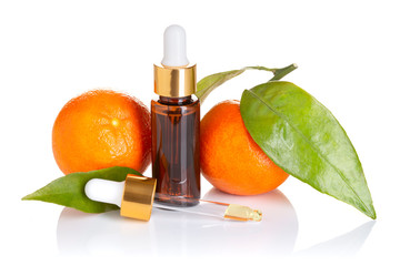 Tangerine essential oil isolated on white background. Tangerine oil for skin care, spa, wellness, massage, aromatherapy and natural medicine. Citrus oil