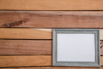 Vintage photo frames on wooden background with space for text and various photos