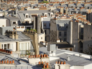Above the rooftops of Paris, detail view with the many red chimneys typical of Paris.