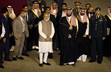 Saudi Arabia's Crown Prince Mohammed bin Salman and India's Prime Minister Narendra Modi pose for a picture after Salman's arrival at an airport in New Delhi