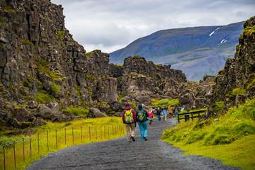 Thingvellir national park, Pingvallavatn huge tectonic plates drifting cracks and tourists on Iceland, summer time Wall mural