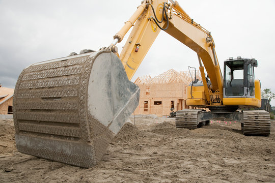 Bulldozer breaking ground at construction site