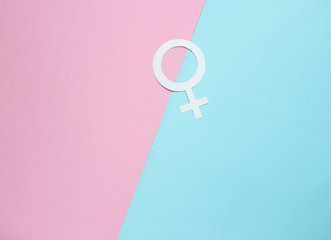 Woman gender symbol on pastel background. Top view. Minimalism. Gender equality