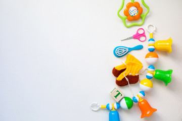 Toys for kids concept. Baby items for newborns. Copy space and top view.