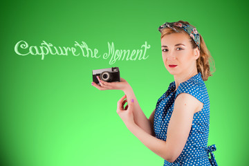 Young woman holding a vintage camera in her hand