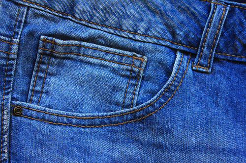 55757624bee Blue Denim Jeans Pocket Design Details with Rivets and Seams Close Up View.  Classic Fashion Jeans Natural Pattern