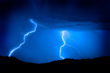 Lightning Bolts on Mountain with Radio Tower Blue Sky