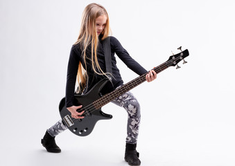 blonde long haired girl is a bass  guitar player