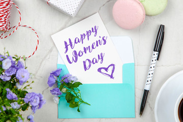 Fotoväggar - Happy Women's Day postcard note on white marble table